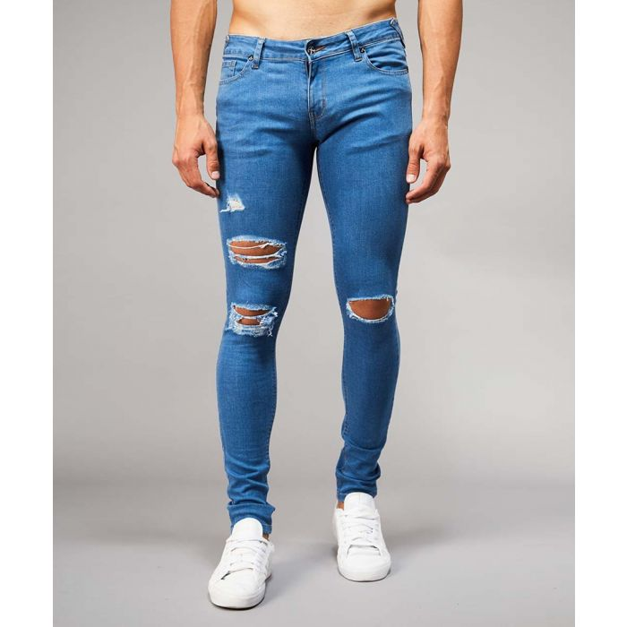 Image for Mid-wash blue cotton blend ripped jeans