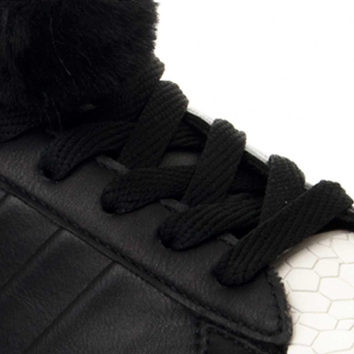 Montevita Pom Pom Sneaker in Black