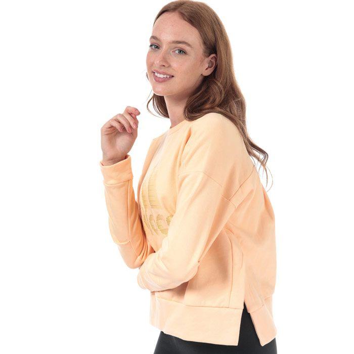 Women's adidas ID Glam Crew Sweatshirt in Peach