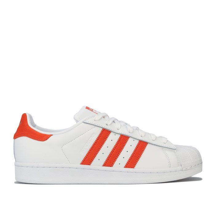 adidas Originals Superstar Trainers in white orange