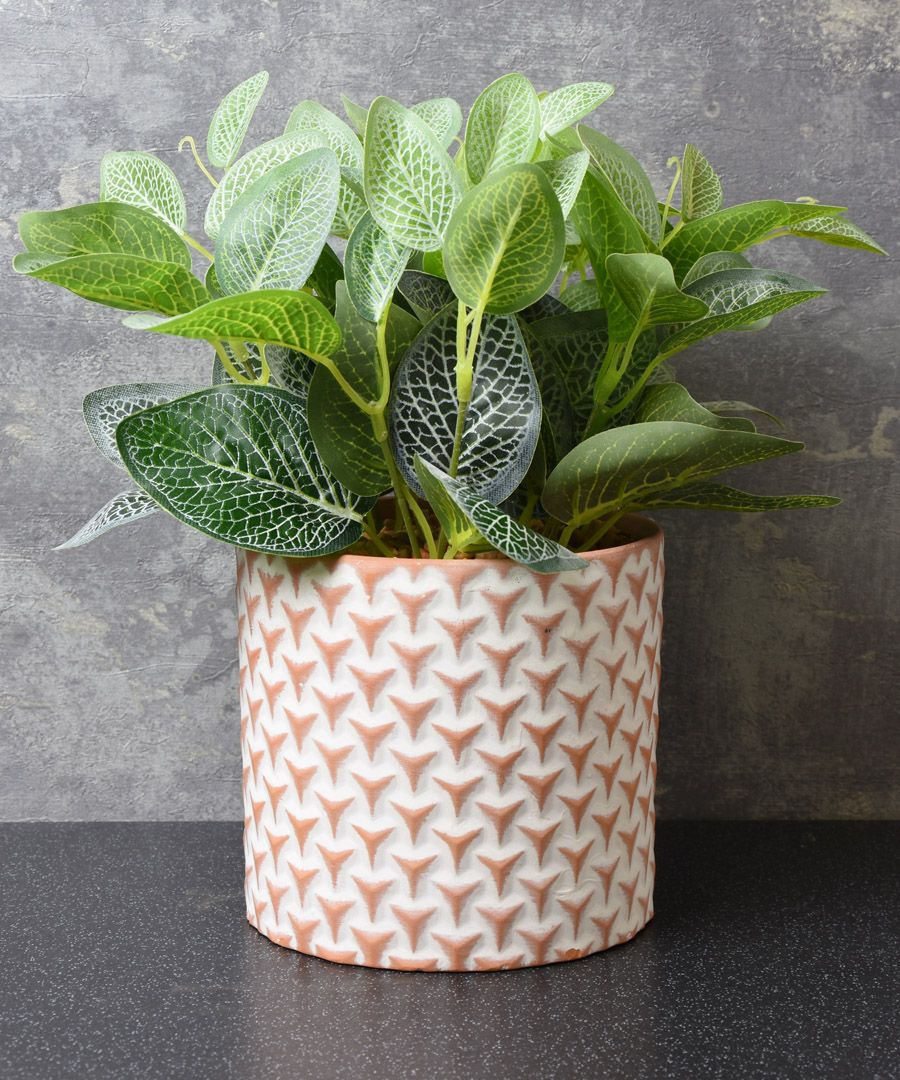 Red cement pot with faux plant