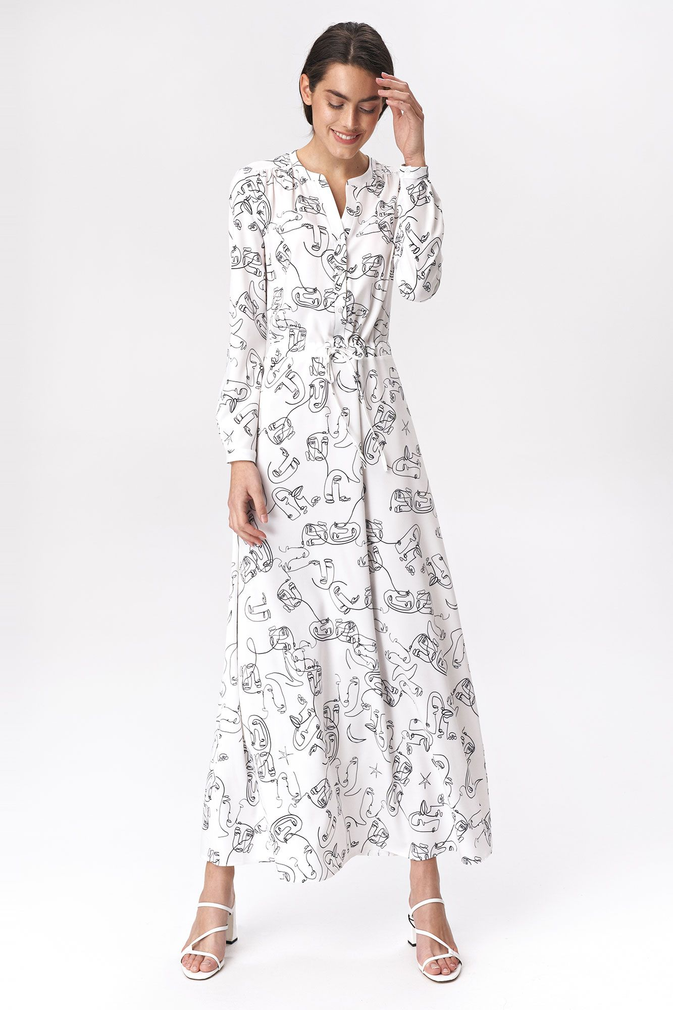 Bright maxi dress with faces pattern